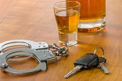 Alcohol, car keys and handcuffs - Forth Worth DWI Penalties Attorney
